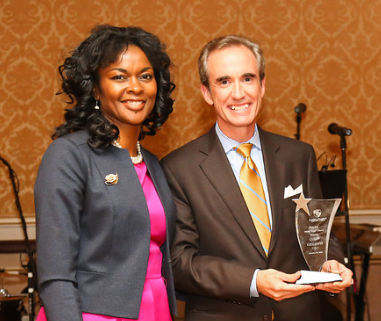 Honoree Colin Gillespie, President of Lego Education, receives his award